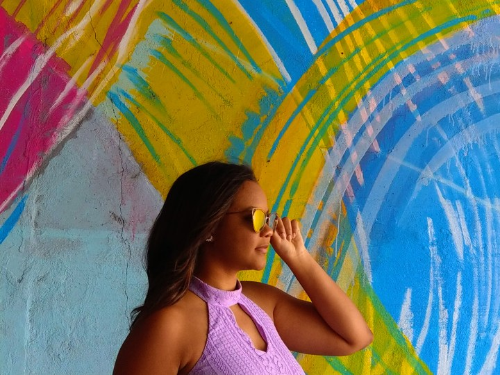 Beautiful girl with blvgari sunglasses 2018 Atlanta street style in lavender with colorful graffiti