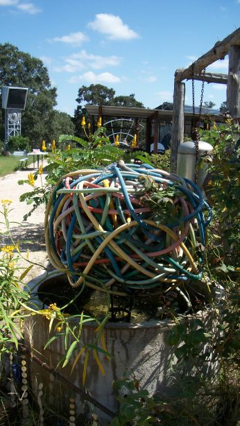A mess of old hoses turned into a cool fountain.