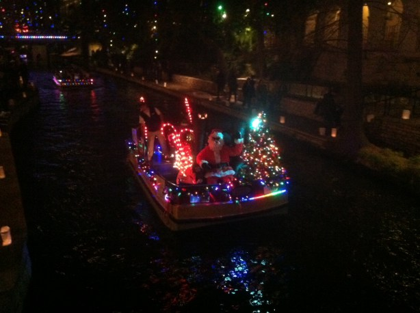 Santa riding on the Riverwalk in San Antonio.