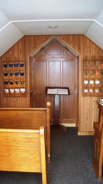 The interior of the tiny church. I know the shot isn't from the best angle, but I was as far back as possible while still being inside.