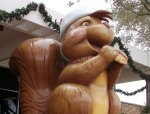 As in real life, the giant squirrel statues are always portrayed munching on a pecan.