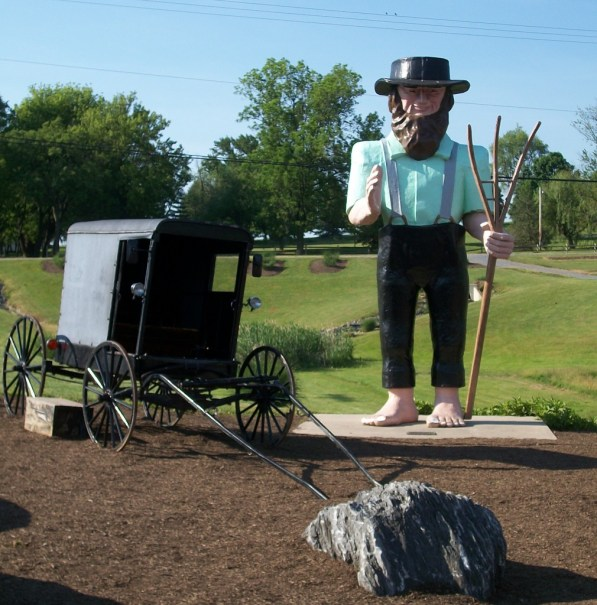 This is Big Amos, the giant barefoot Amish statue. He's in Strasburg, PA, standing next to regular buggy.