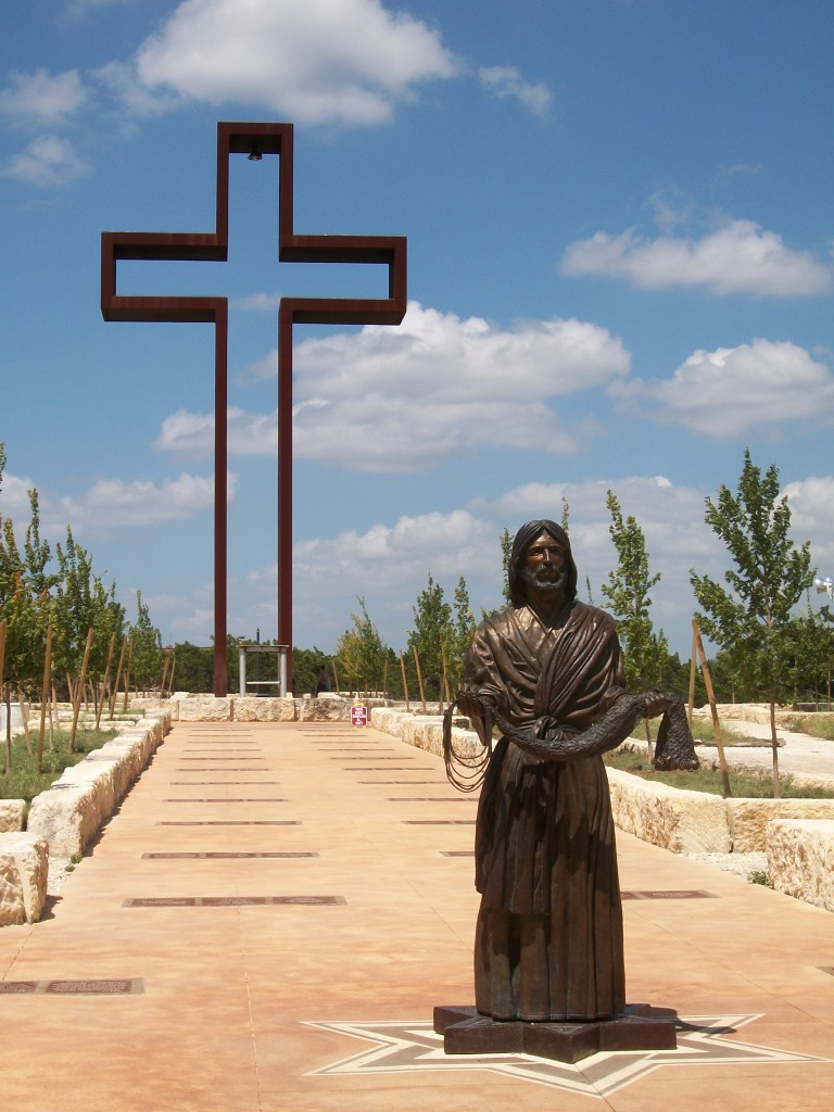 The Empty Cross and bronze sculpture.