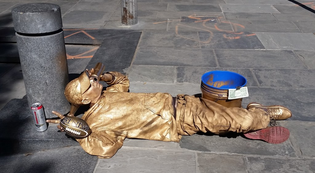 Street performer in gold
