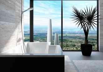 Modern bathtub in a bathroom interior with floor to ceiling window