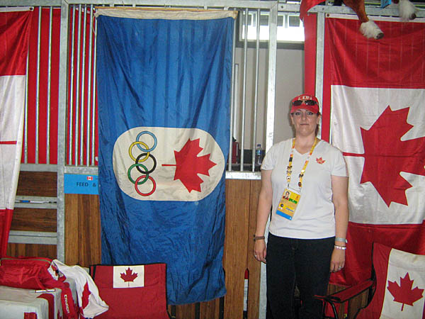 in front of the Canadian Dressage Team's tack stall with a vintage Olympic flag....I gotta work on a more relaxed casual pose