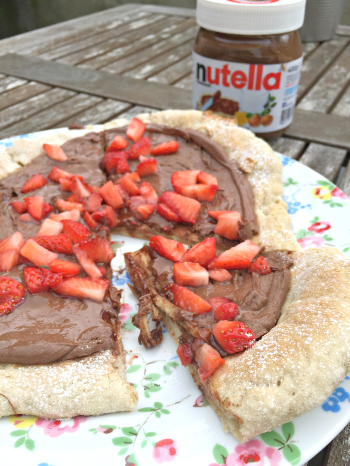 Love pizza? you'll go crazy for dessert pizza! Strawberry Nutella Pizza - or try another combination like banana and caramel