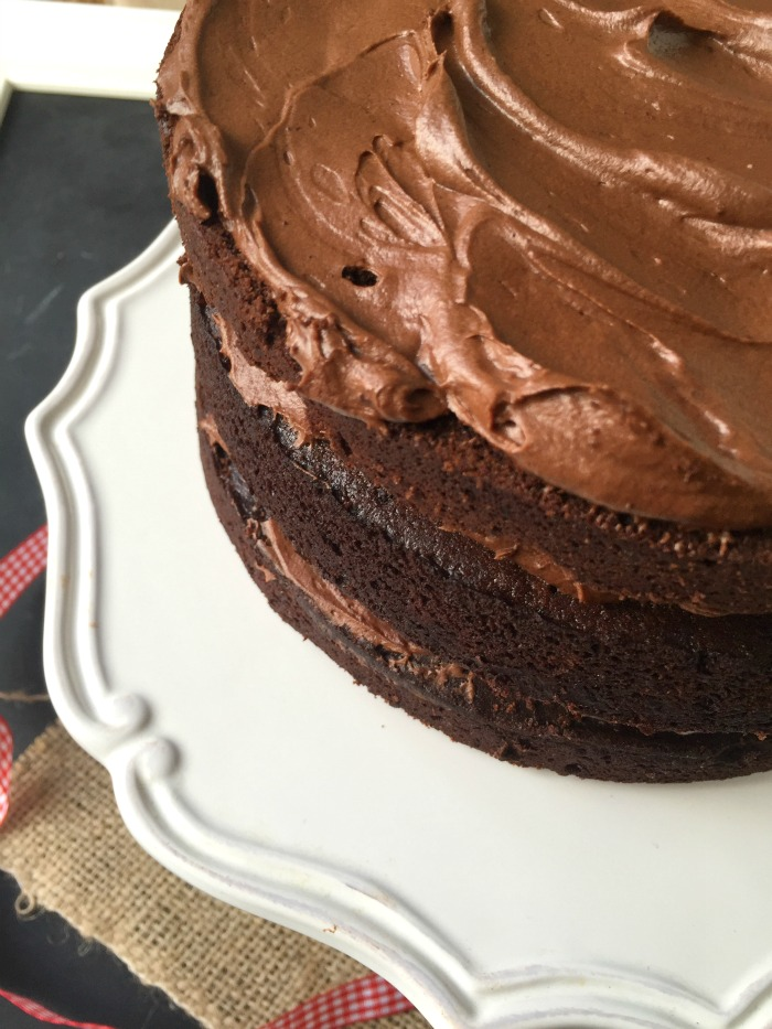 Need an awesome cake using only basic ingredients you have NOW? This is the cake for you! Easy, quick, and no mixer needed either. Meet the best classic easy one-bowl chocolate cake!