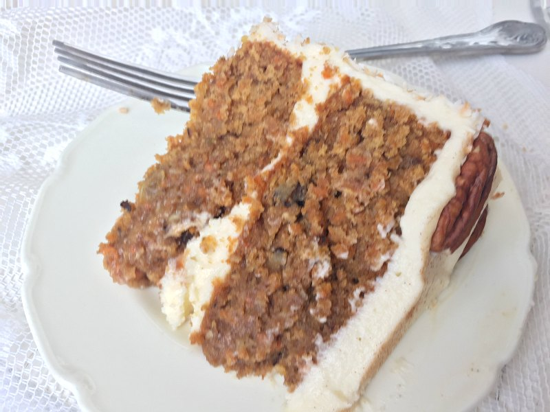 This would be so PERFECT for Easter lunch! A recipe for a moist, soft and delicious two-layer Carrot Cake covered in foolproof Marscapone Cream Cheese Frosting. Easy, and no mixer required!