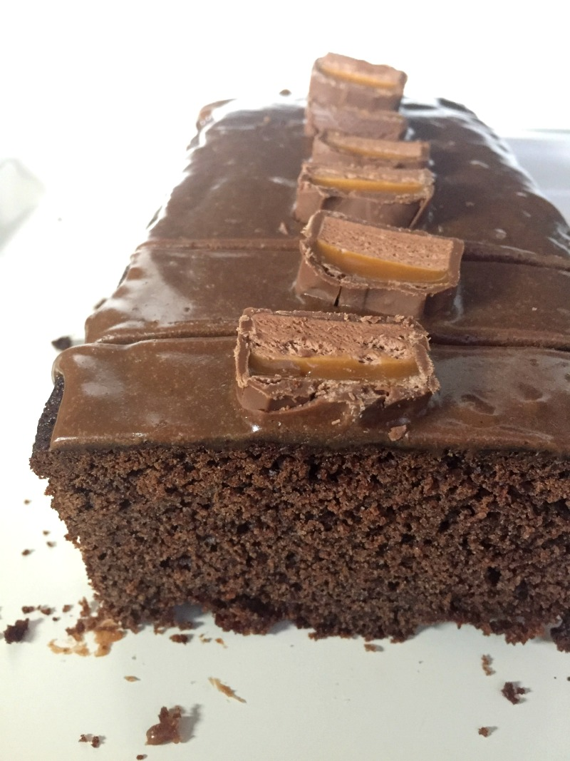 A delicious recipe for a simple Mars Bar Chocolate Loaf Cake, topped with a yummy mars bar glaze and decorated with more mars bars!