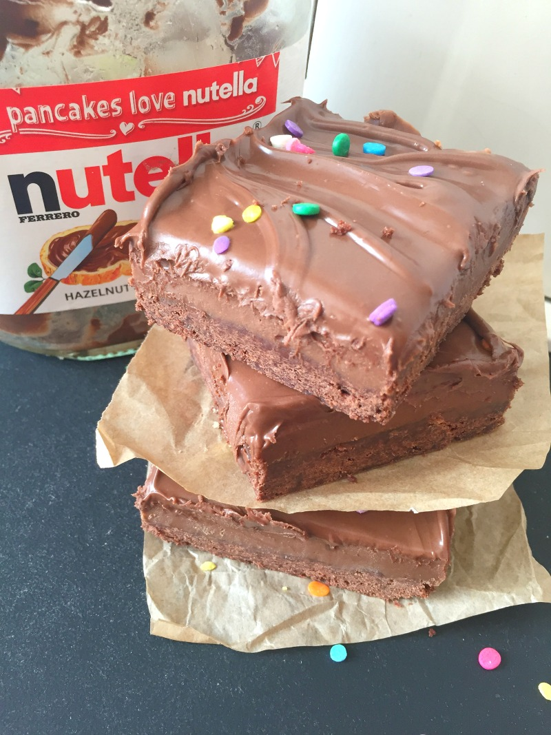 They're really real.... the ultimate Nutella treat and you can bake it in 30 minutes!! Chocolate shortbread, thick nutella flavoured caramel, all topped with more Nutella! Easy, ready in 30 minutes and ridiculously delicious. Easy Nutella Millionaires Shortbread Bars Recipe from Kerry at http://Kerrycooks.com