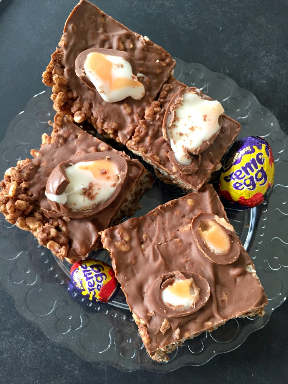 Ridiculously moreish three ingredient Creme Egg Rice Krispie Cakes - like your favourite chocolate Rice Krispie Treat but with added Creme Eggs! Great no-bake Easter treat