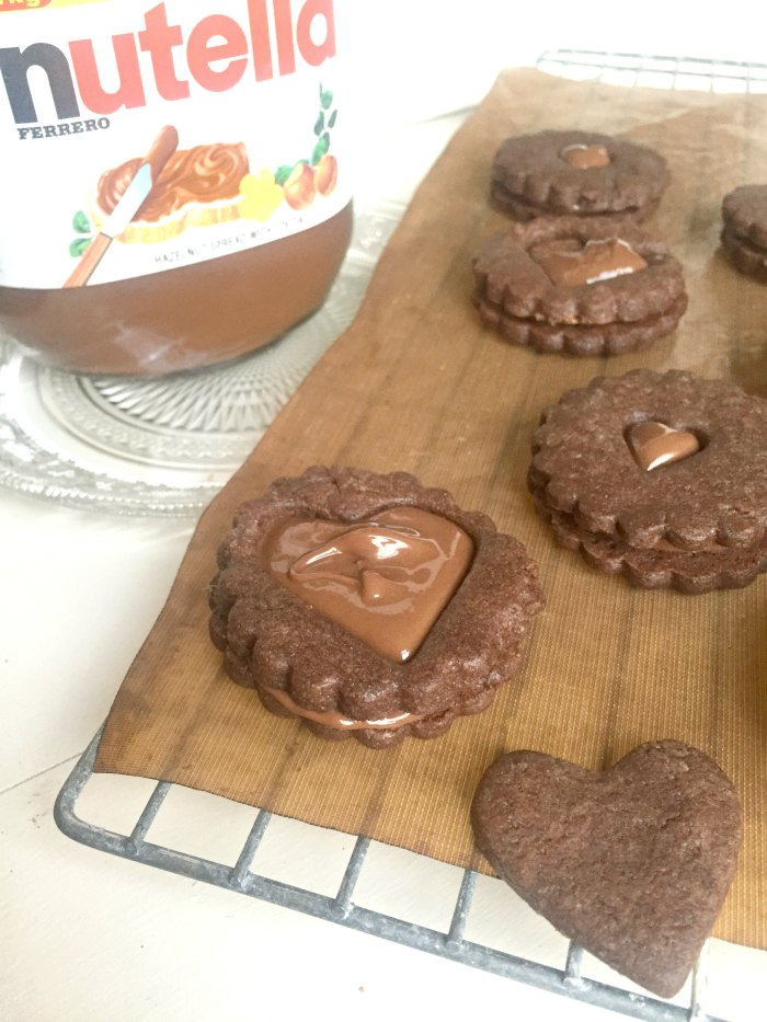 Nutella Dodgers Recipe {Nutella Sandwich Cookies} = Like a Jammy Dodger, that's been given a Nutella makeover! Easy to make chocolate cookies are sandwiched together with delicious Nutella...