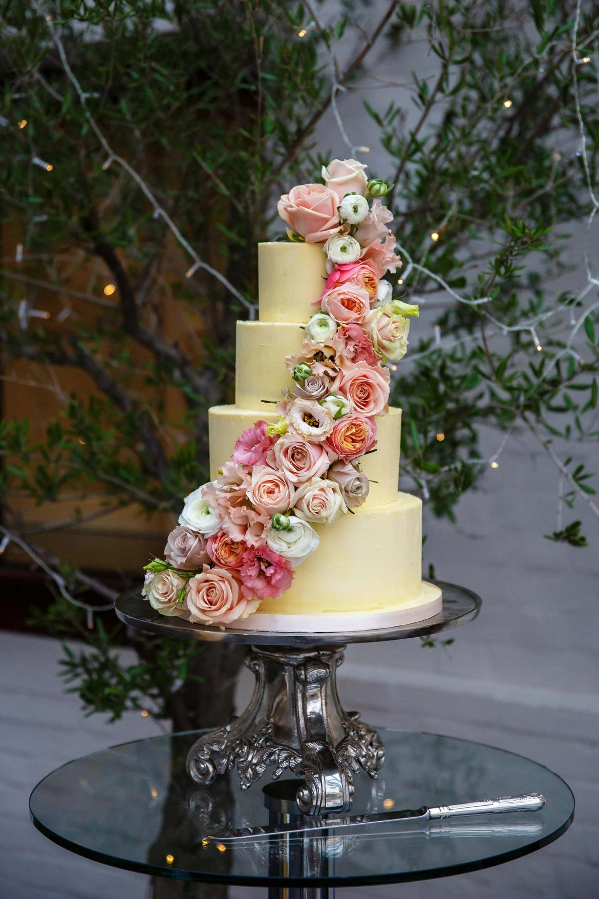 cream wedding cake with flowers