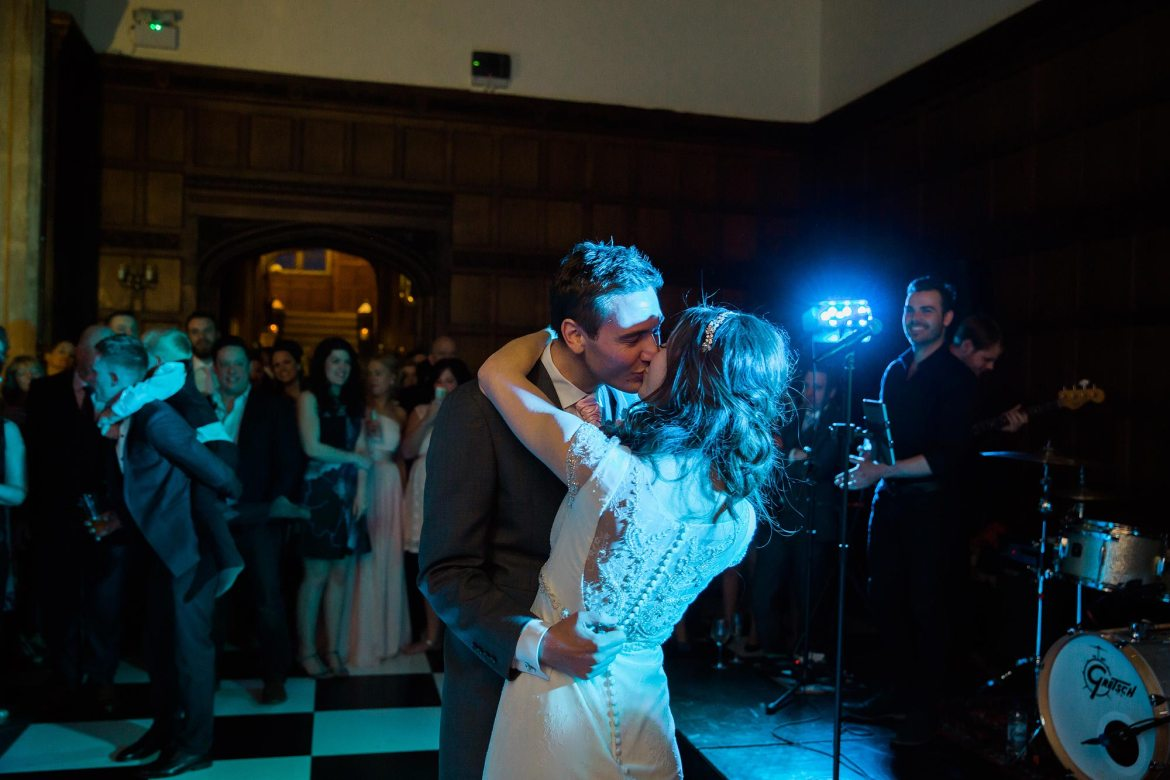 The couple kiss on the dance floor