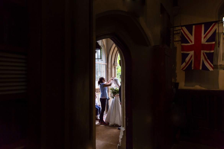 Bride has her veil adjusted