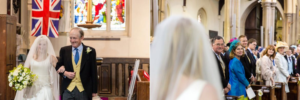 guests watching the bride walk down the aisle of All Saints Fulham