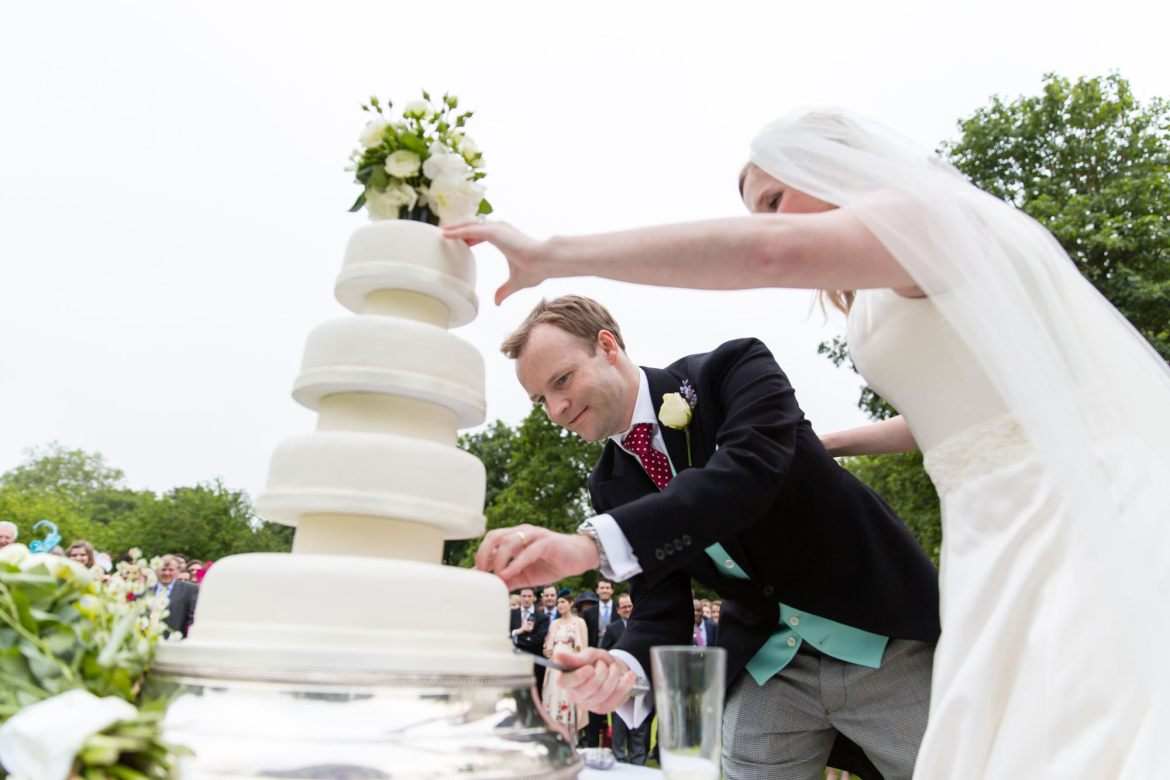 A close up of the cake cutting