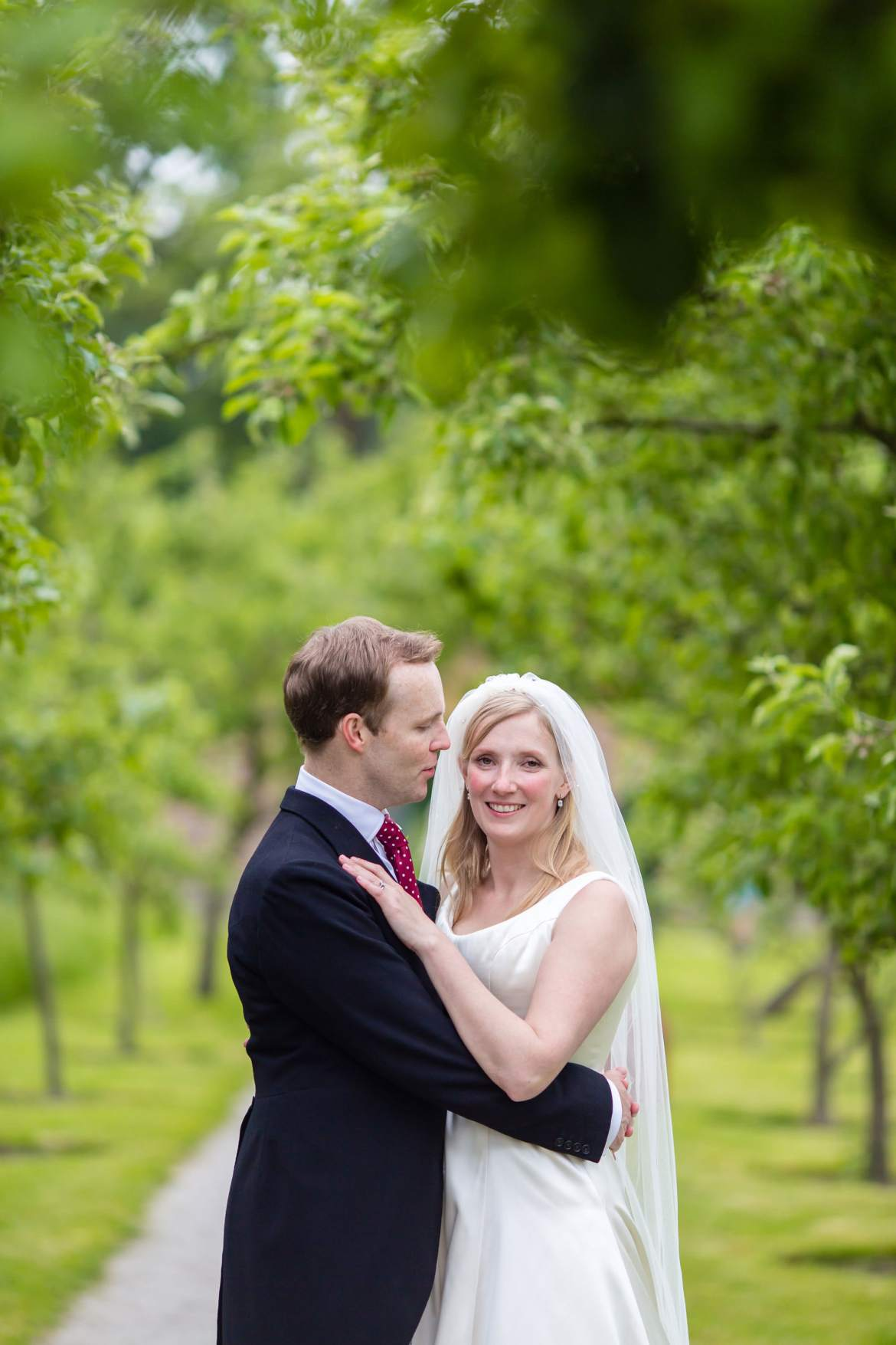 pictures of the bride and groom in the walled garden
