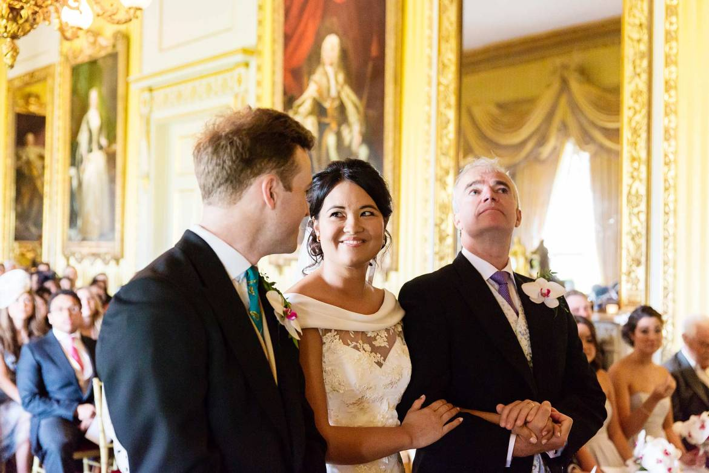 Rachel looks into Kieran's eyes as their Goodwood House wedding starts