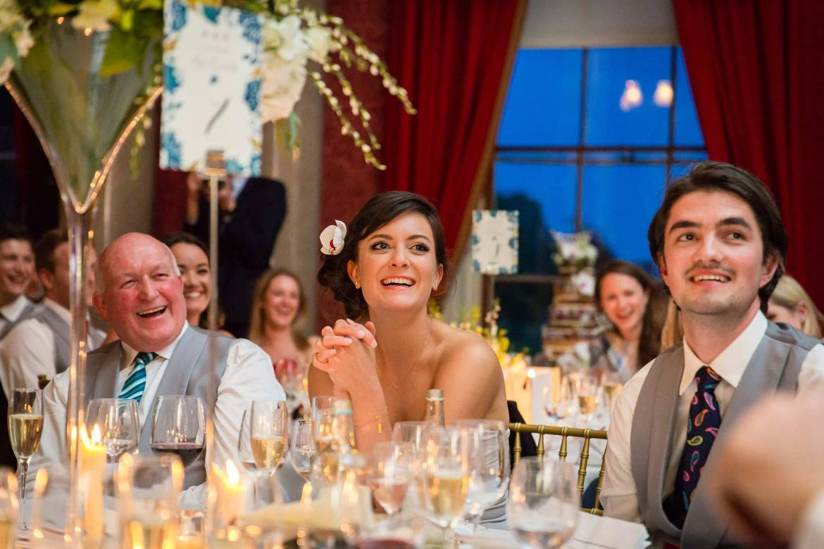 guests laughing at kieran's speech