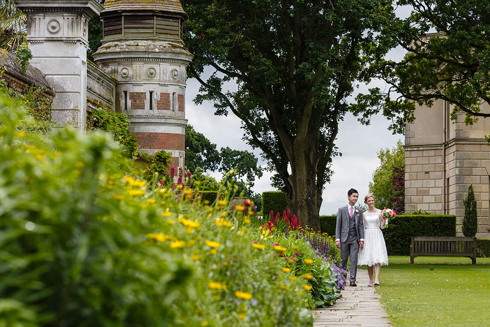 The couple walk through the gardens at Cliveden House