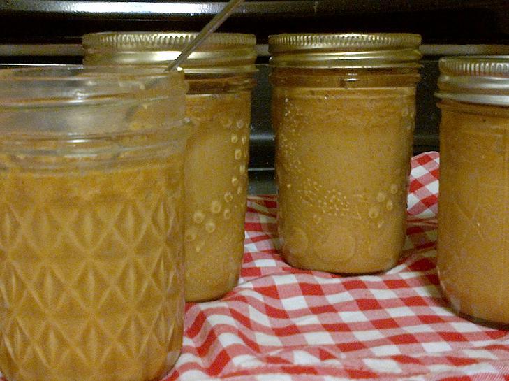 four jars of prepared caramel sauce