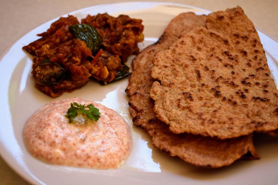 Eggplant 'bharta' with flaxseed naan and yogurt chutney.
