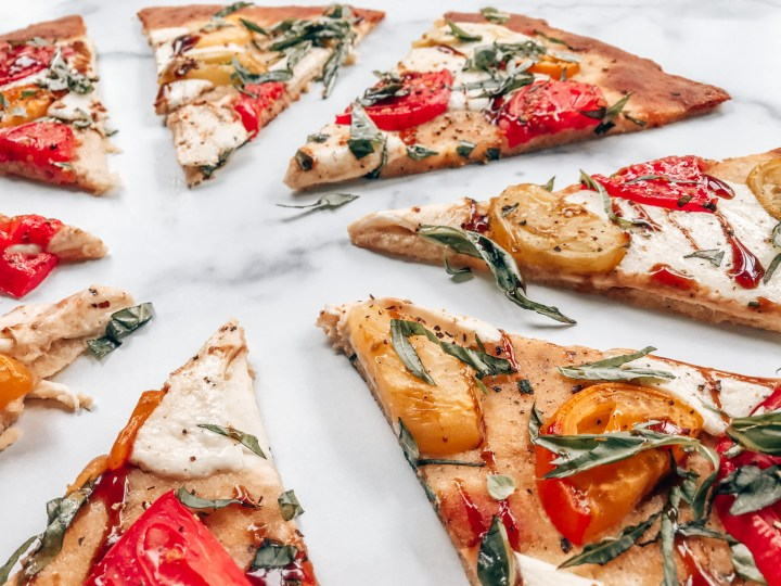 Crispy pizza crust with tomatoes, basil, cheese and balsamic