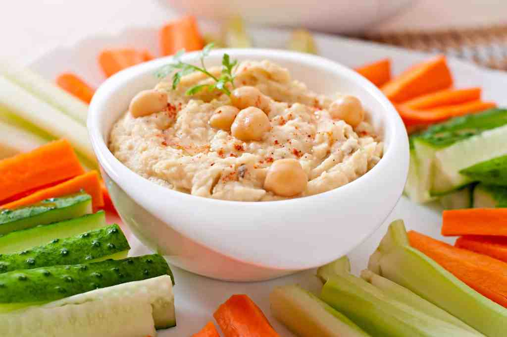 Is Hummus Keto Friendly? - a bowl full of hummus with vegetables for dipping