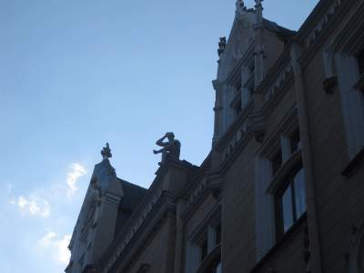 Riga loves to put sculptures of cats, people, and other stuff on top of its buildings.