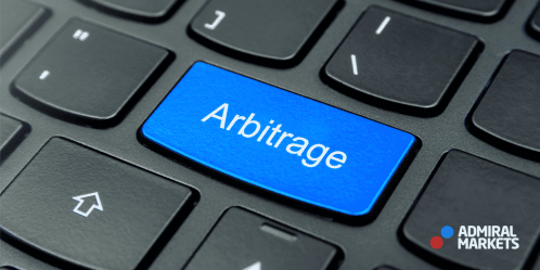 picture of compute keyboard with the word Arbitrage