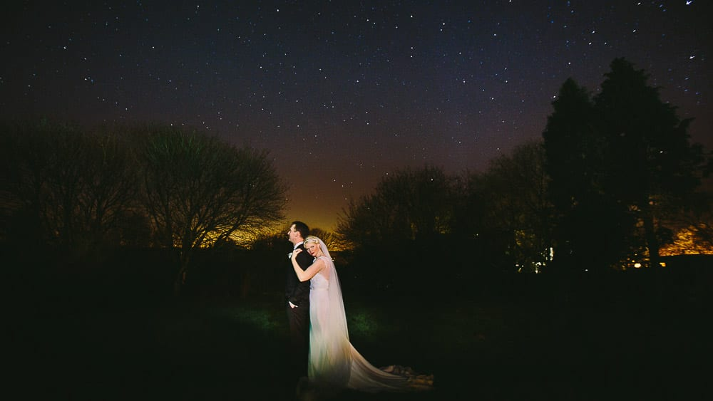 A romantic portrait of the bride and Groom under the stars