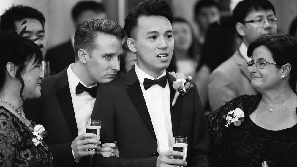 Two grooms crying during the speeches