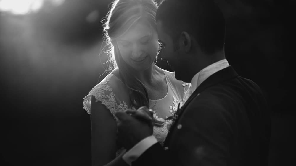 Black and white image of bride and groom rehearsing first dance