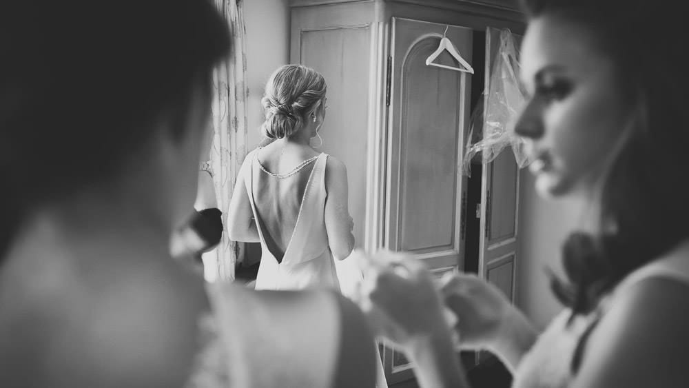 Black and white image of bride ready for her wedding at Great Tythe Barn