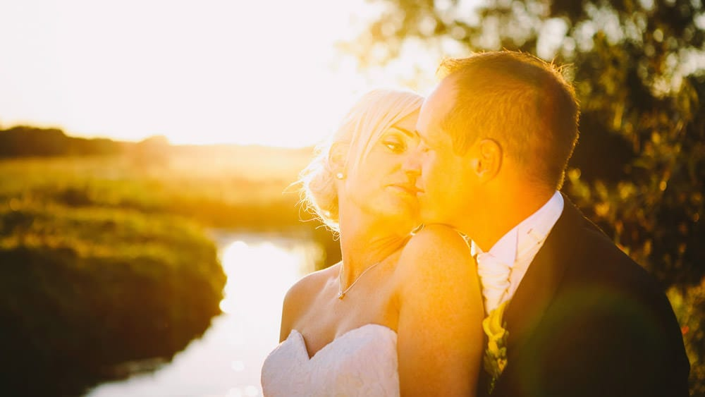 Sunset portrait of bride and groom at Sopley Mill