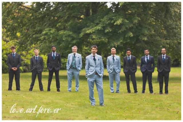 The groom and ushers on the lawn at Chilworth Manor