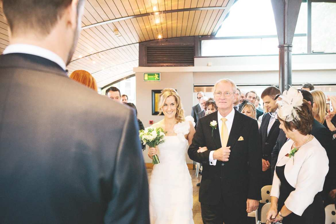 the bride and her father walk up the aisle