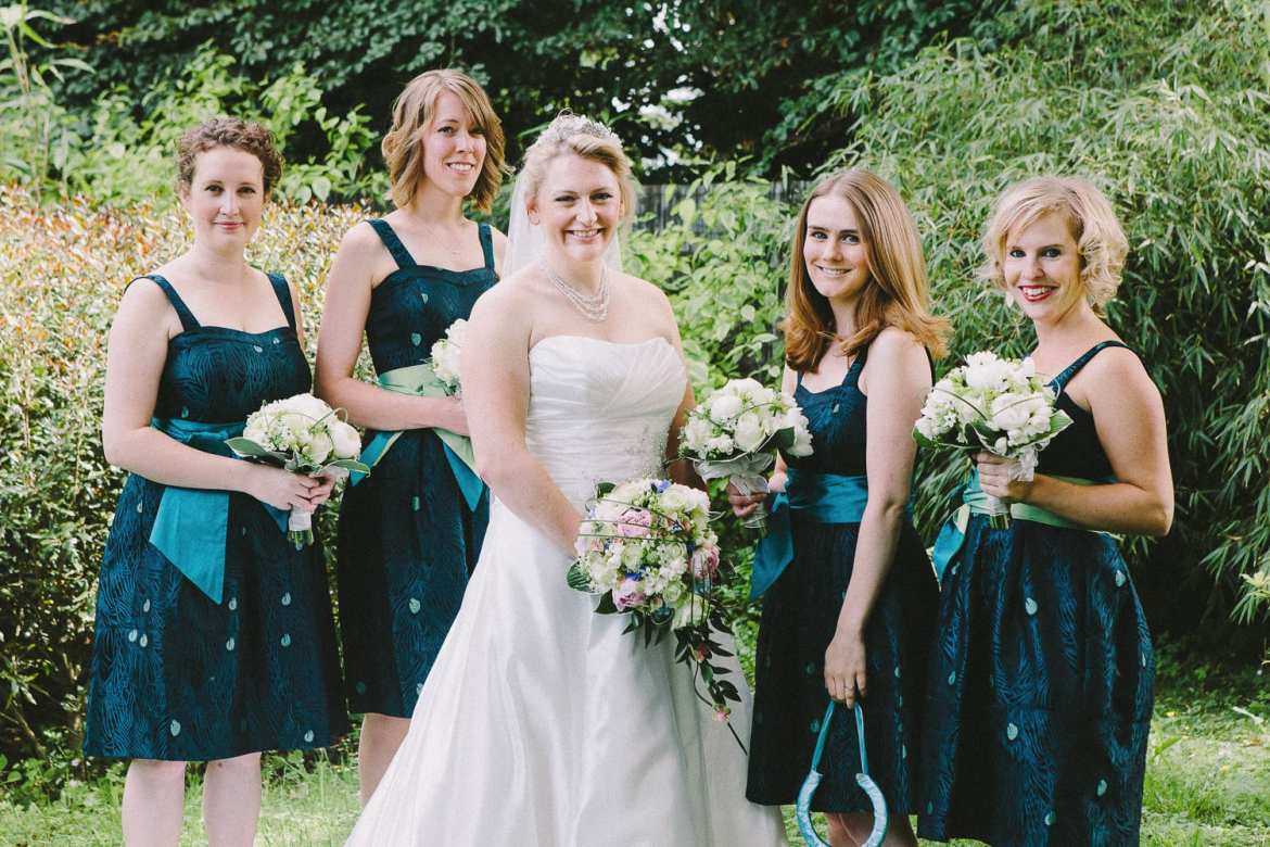 Bride and bridesmaids in their peacock themed dresses