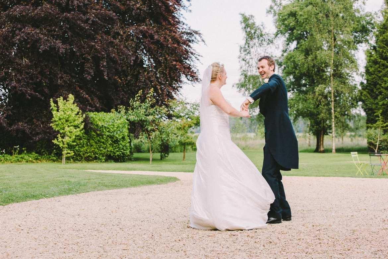 The newly married couple dance outside Kingscote Park House