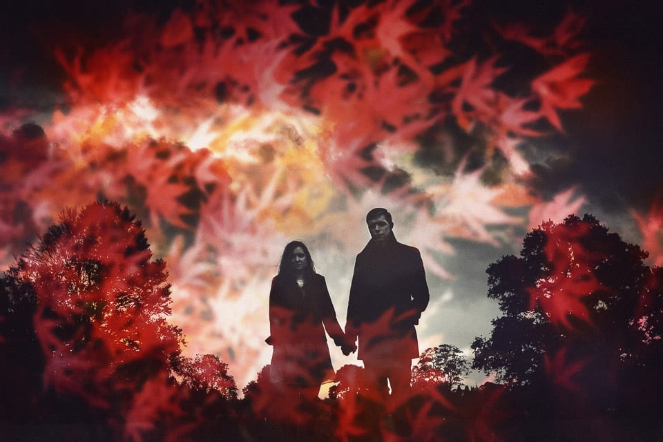 Double exposure of engaged couple taking a walk at Westonbirt Arboretum