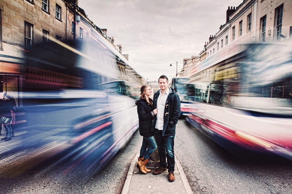 Engaged couple stand in traffic  in Bristol
