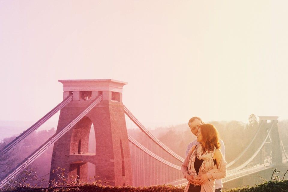 Sunset image of engaged couple at Clifton Suspension Bridge