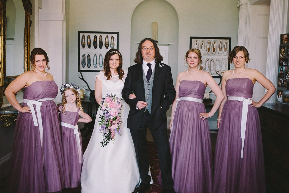 bride with father and bridesmaids