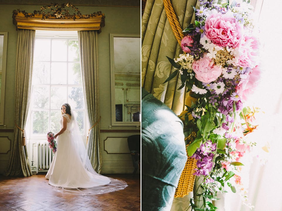 bride in window with flowers