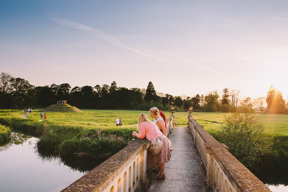bridal party on a bridge at sunset