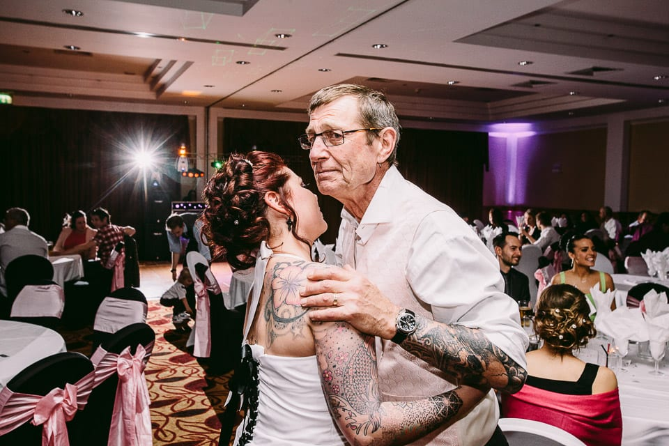 tattooed bride and father