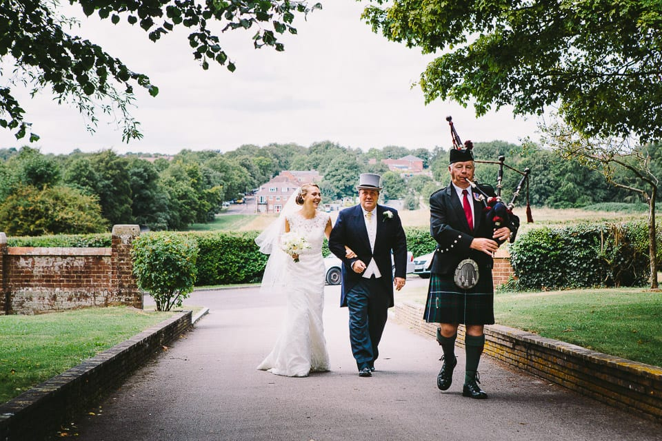 bride, father and piper