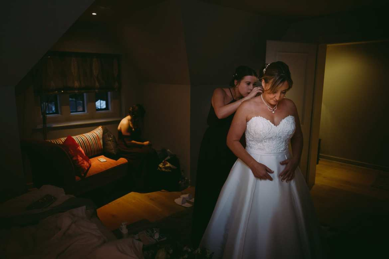 bridesmaids helping the bride